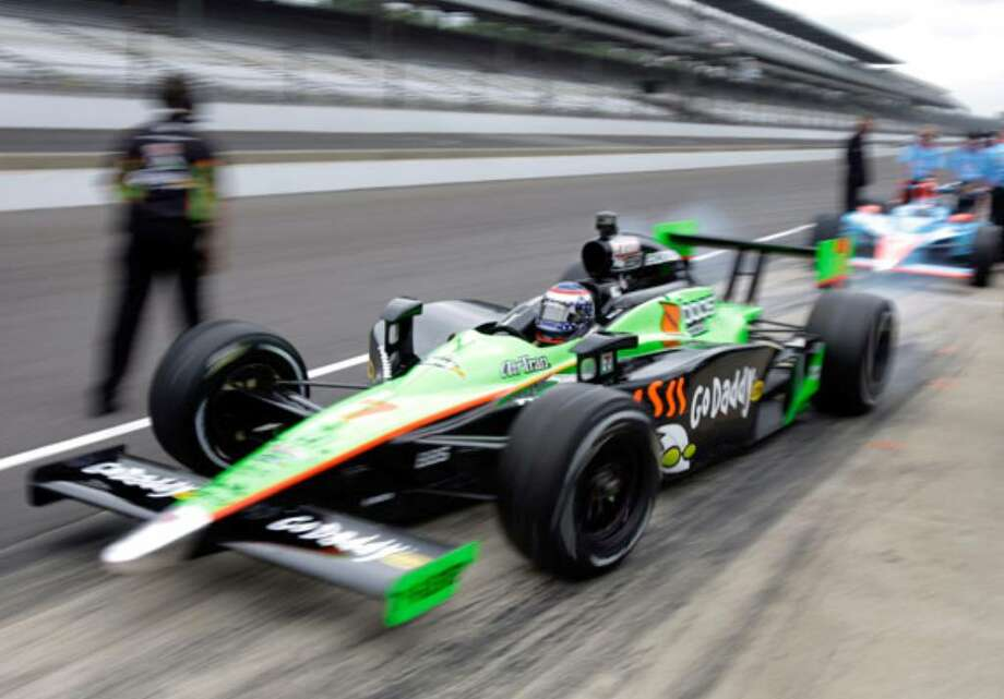 Danica Patrick speeds out of the pit area during a practice session for Sunday's running of the Indianapolis 500.