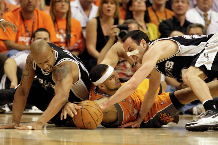 Spurs Keith Bogans, left, and Manu Ginobili scramble for a loose ball with Suns Jared Dudley. / glara@express-news.net