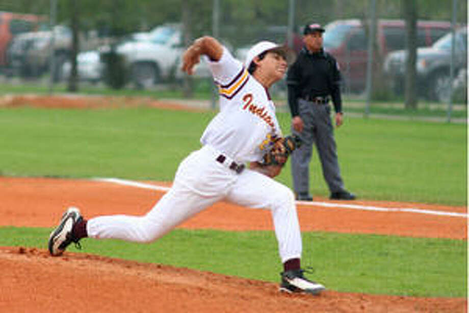 Harlandale sophomore Michael Agis makes a pitch against Southside during Friday's game.