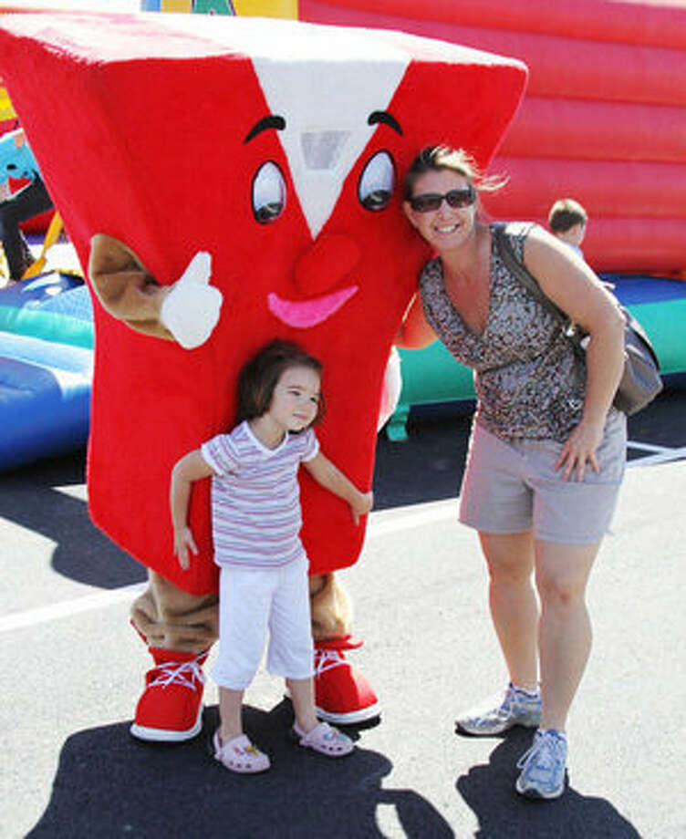 A young girl poses with the YMCA mascot during Saturday's Community Day at the new facility.