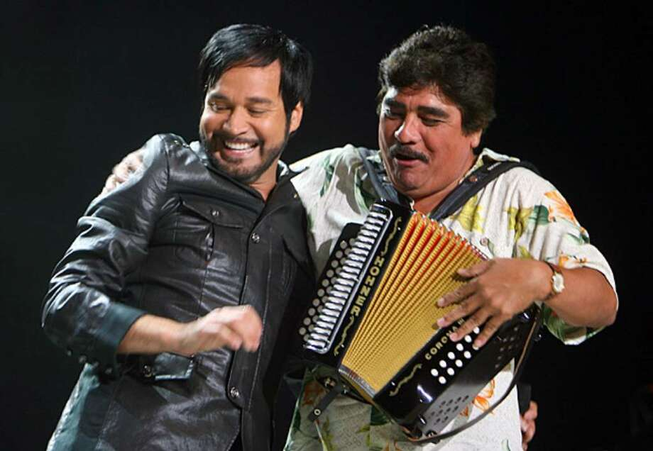 La Mafia's lead singer Oscar De La Rosa and accordionist Celso Piña perform during the 30th anniversary concert.
