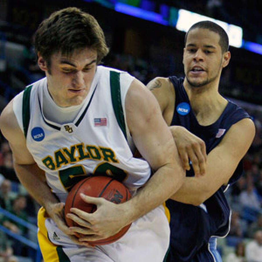 Baylor's Josh Lomers secures a rebound in front of Old Dominion's Gerald Lee during the first half Saturday.