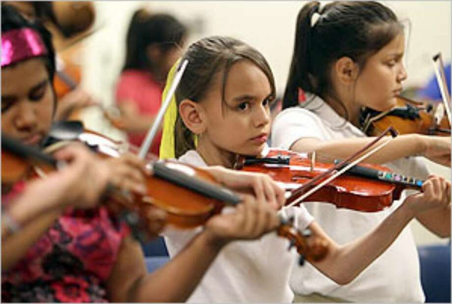 Yliana Beck, 9, practices during violin class at the UTSA Downtown String Project.