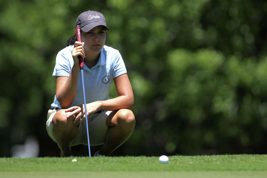 Paola Moreno from Cali, Colombia lines up a putt on hole 8 during the Texas Hill Country Classic Duramed Futures Tour at Dominion, Sunday, May 2, 2010. / spoecial to the San Antonio Express-News