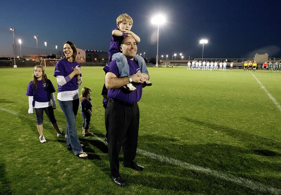 Christopher and Stephanie Fincke along with their children help kick off the Fincke Cup soccer match between Reagan and Johnson at Blossom Soccer Stadium on Tuesday, Mar. 9, 2010. The Fincke Cup is in honor of their oldest son, Ian, who died from injuries of a skateboarding accident in 2008. / San Antonio Express-News