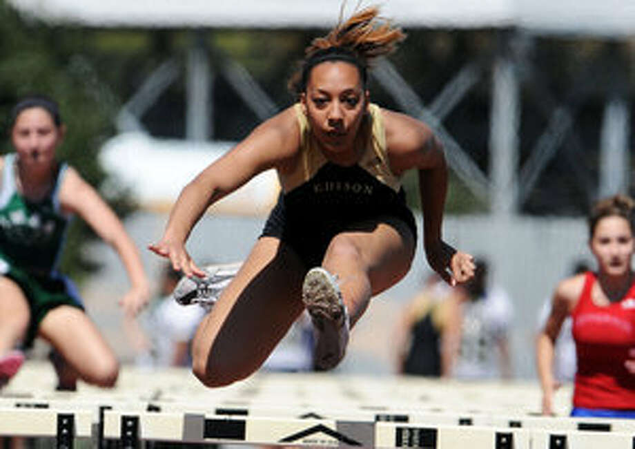 Edison's Dezirae McKey clears the final hurdle en route to a second-place finish in the girls' 100-meter hurdles at Saturday's Harlandale Relays with a time of 16.55.