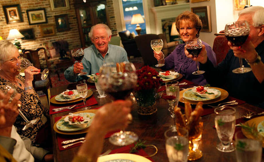 Lyn Mason (from left), host Bill Harrison, Connie Hudson and Robert Bryant share a toast. The Harrisons entertain as often as once a week. / SAN ANTONIO EXPRESS-NEWS