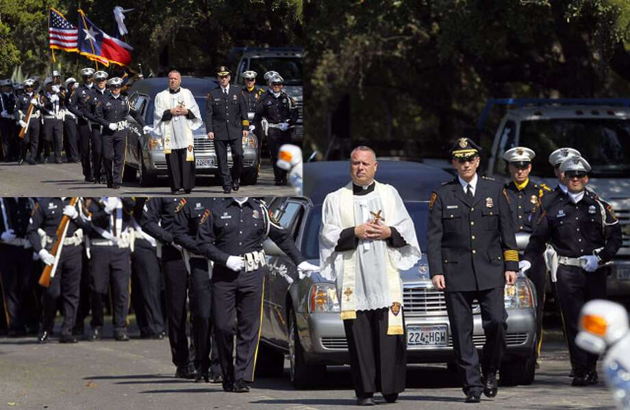 Father Jimmy Drennan (left, in white) and San Antonio Police Chief William McManus (right) lead the procession during the funeral of San Antonio Police Officer Sergio Antillon at Resurrection Cemetery Tuesday November 2, 2010. Antillon died October 29, 2010 from injuries sustained after he was hit by an alleged drunk driver on October 14.