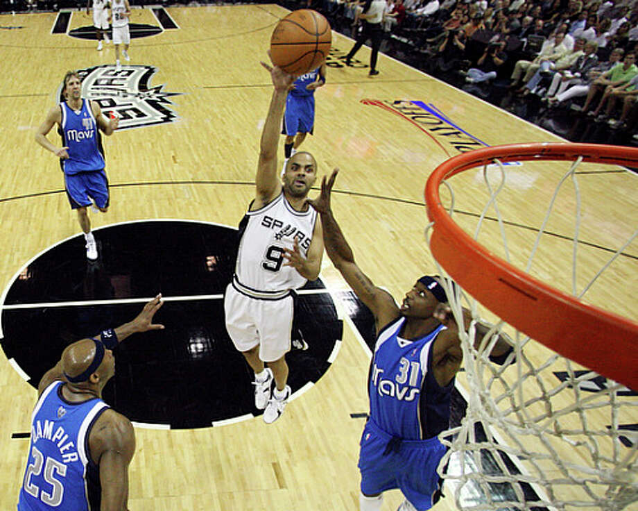 Tony Parker unleashes his trademark teardrop shot over the Mavs? Jason Terry in Game 3. / © 2010 SAN ANTONIO EXPRESS-NEWS