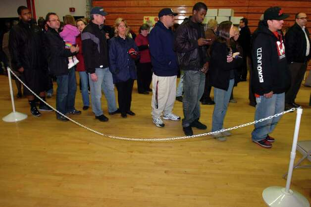 People wait to vote at Central High School, in Bridgeport, Conn. on election night, Nov. 2nd, 2010. Photo: Ned Gerard / Connecticut Post