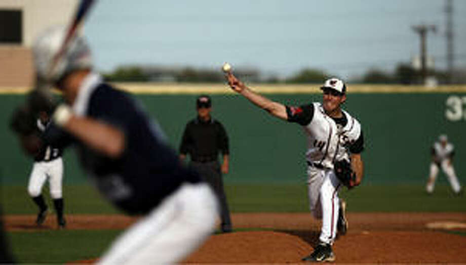 Churchill's Reed Kirksey pitches to Smithson Valley's Logan Huesing during the teams' key District 26-5A game.