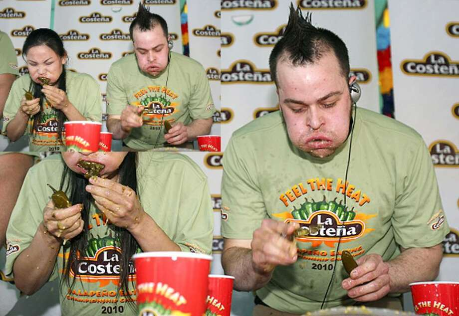 Sonya 'The Black Widow' Thomas and Patrick 'Deep Dish' Bertoletti compete in the 4th Annual La Costeña 'Feel the Heat' Jalapeño Eating Championship Challenge held Sunday.