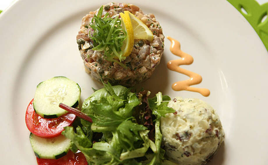 Cold plates, such as this Tuna Tartare with two salads, were among the best offerings at the new restaurant. / SAN ANTONIO EXPRESS-NEWS
