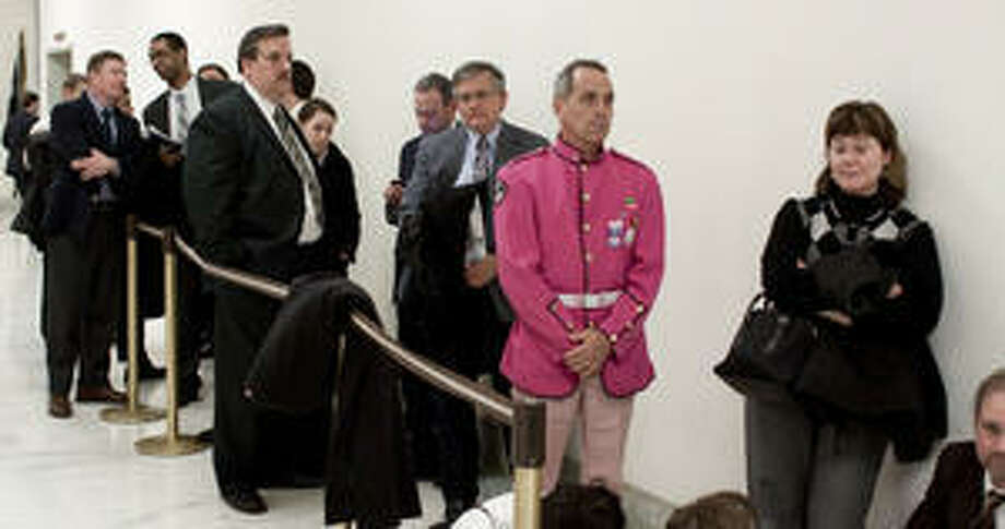 Tighe Barry, in a pink uniform, lines up with others for a recent House Armed Services subcommittee hearing on the repeal of ?don't ask, don't tell? on gays in the military. A reader hailed the comments of guest columnist Patrick Brady on the subject.