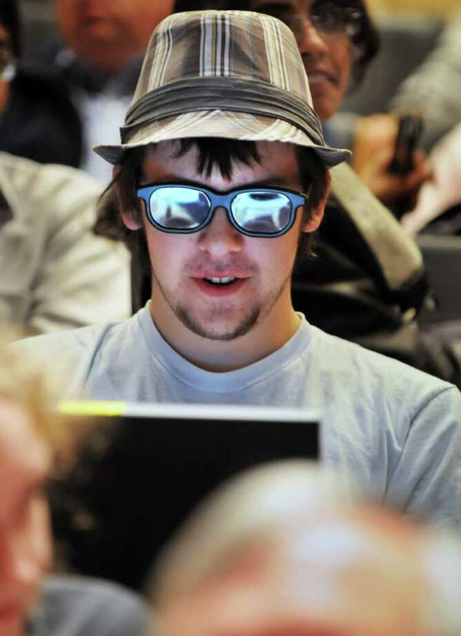 RPI student Vincent Riemer of Canton,Mass., wears 3-D glasses during a demonstration of new technologies by Microsoft chief research and strategy officer Craig Mundie at RPI's EMPAC building in Troy Tuesday afternoon November 2, 2010.   (John Carl D'Annibale / Times Union) Photo: John Carl D'Annibale / 00010908A
