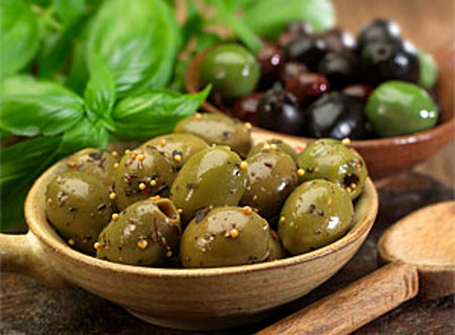 Warm Olives with Wild Herbs is a recipe that combines olives, shallot and mustard seeds.