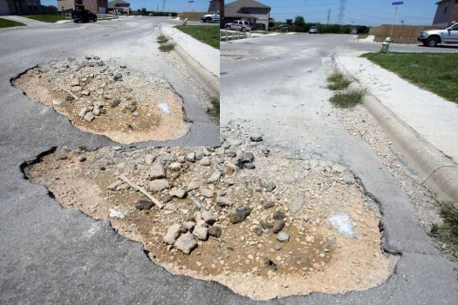 One pothole in the Ventura Heights neighborhood near Heights Valley and Beech Trail takes up about half of the road. Homeowners may have to pay for repairs because they are not considered public roads.