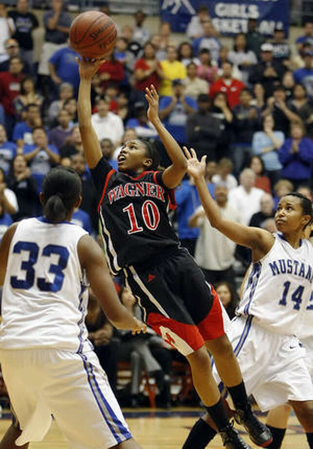 Wagner's LenNique Brown (10) drives to the basket between Jay's Maretta Stubbs (33) and Kiara Taylor (14) during the Class 5A girls regional finals Saturday.