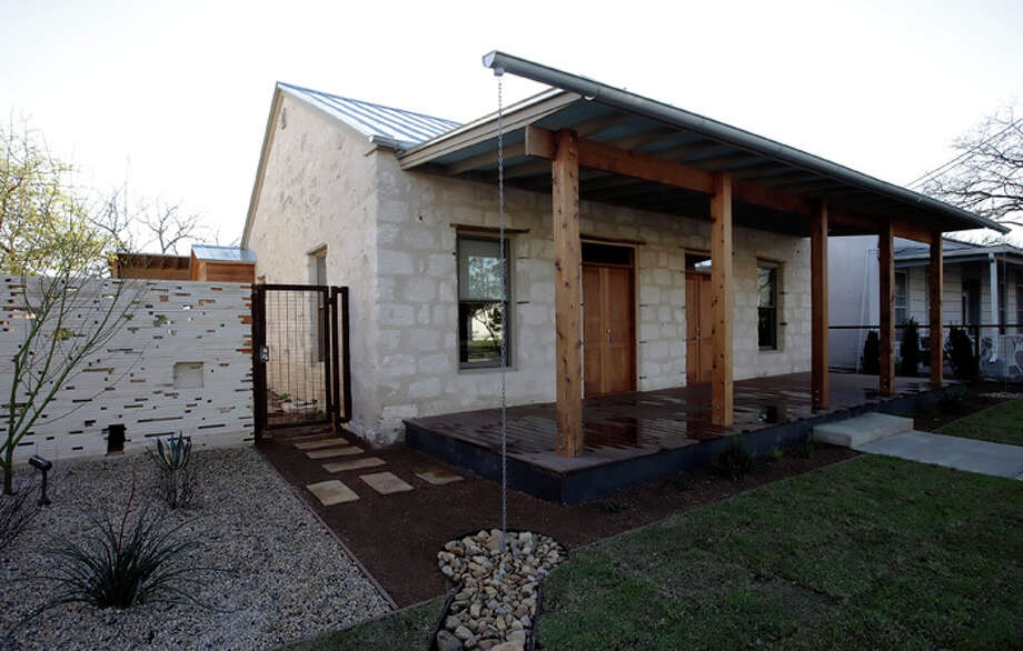 Owners Mike and Pam McClain left the suburbs to undertake a major renovation and addition to this limestone block home in Lavaca. / San Antonio Express-News