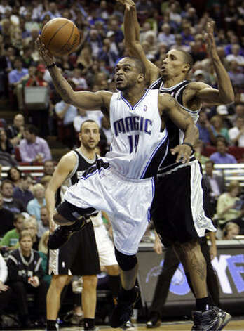 Orlando's Jameer Nelson goes to the basket past Spurs guard George Hill during the second half. Hill scored two points on just 1-of-5 shooting.