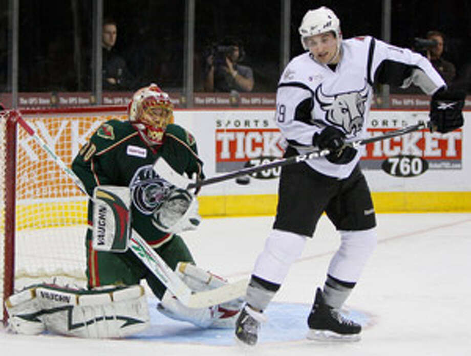 The Rampage's Brett MacLean tries to deflect a shot past Houston Aeros goalie Anton Khudobin during the second period Wednesday night at the AT&T Center.