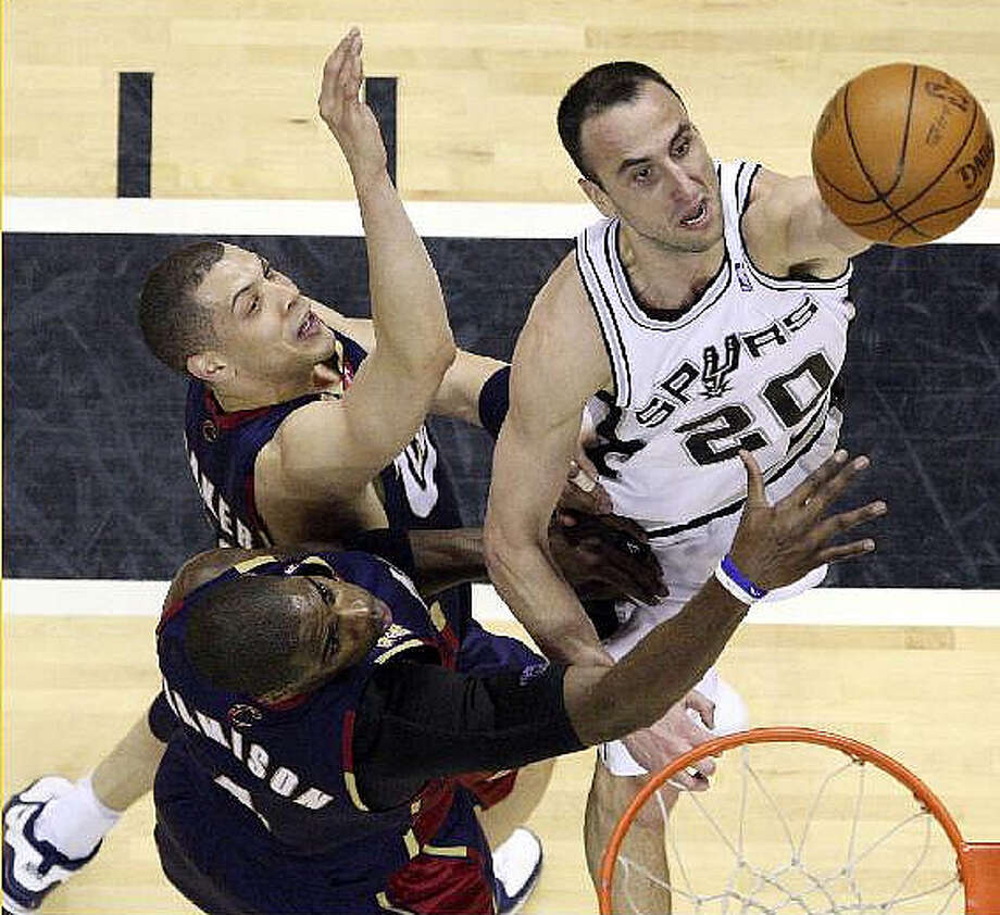 The Spurs' Manu Ginobili lays the ball up against the Cavaliers' Antawn Jamison (bottom left) and Anthony Parker. Ginobili finished with 30 points.