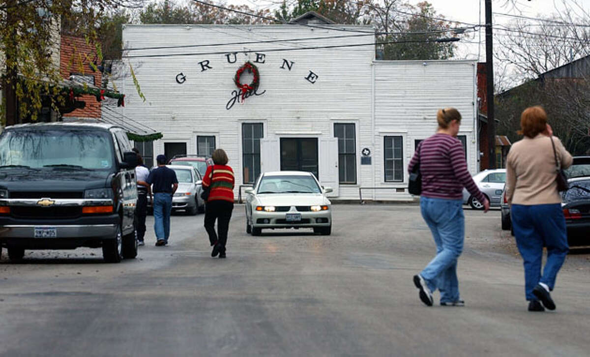 Shoppers walk the streets of Gruene Dec. 26, 2003. The historic area, anchored by Gruene Hall, has been growing since the late '70's yet has had to change little to accommodate the increased tourism.