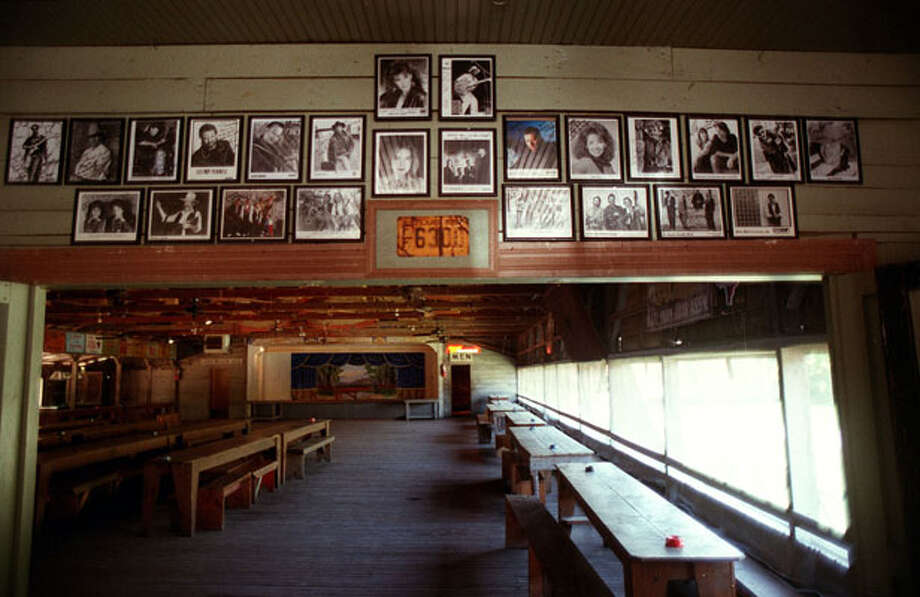 Photo of entertainers who have played Gruene Hall line the walls.