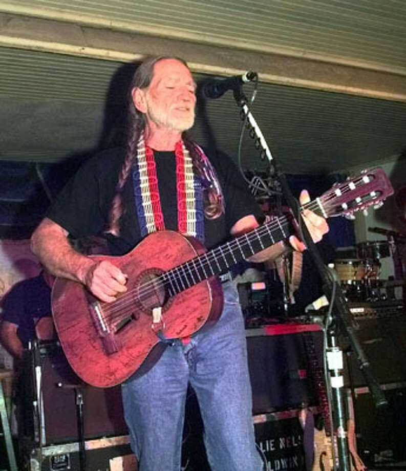 Willie Nelson  performs at Gruene Hall in a  benefit for flood victims in Comal County on Dec. 3, 1998.