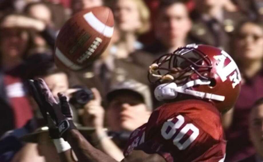 Chris Cole hauls in a pass that set up the Aggies to win against the Longhorns at Kyle Field in 1999. The Aggies scored on the next play and won 20-16.