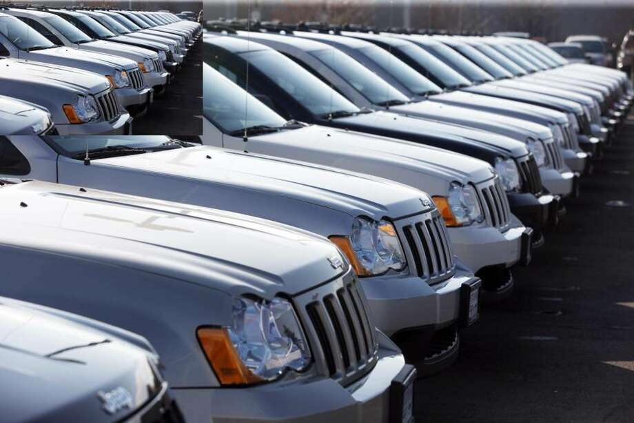 These Jeep Grand Cherokees sit at a Chrysler Jeep dealership. The model is part of a U.S. sales increase of 25 percent, the best year-over-year percentage sales improvement for the company in almost five years.