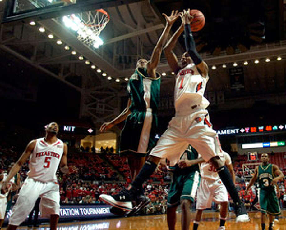 Texas Tech's Brad Reese (right) pulls down a rebound over Jacksonville's Travis Cohn during the second half of their second-round NIT game. Reese had 19 points and 10 rebounds.