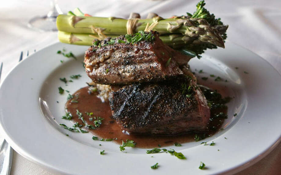 The Vineyards serves a rack of lamb, one of several classic dishes prepared very well. / SAN ANTONIO EXPRESS-NEWS