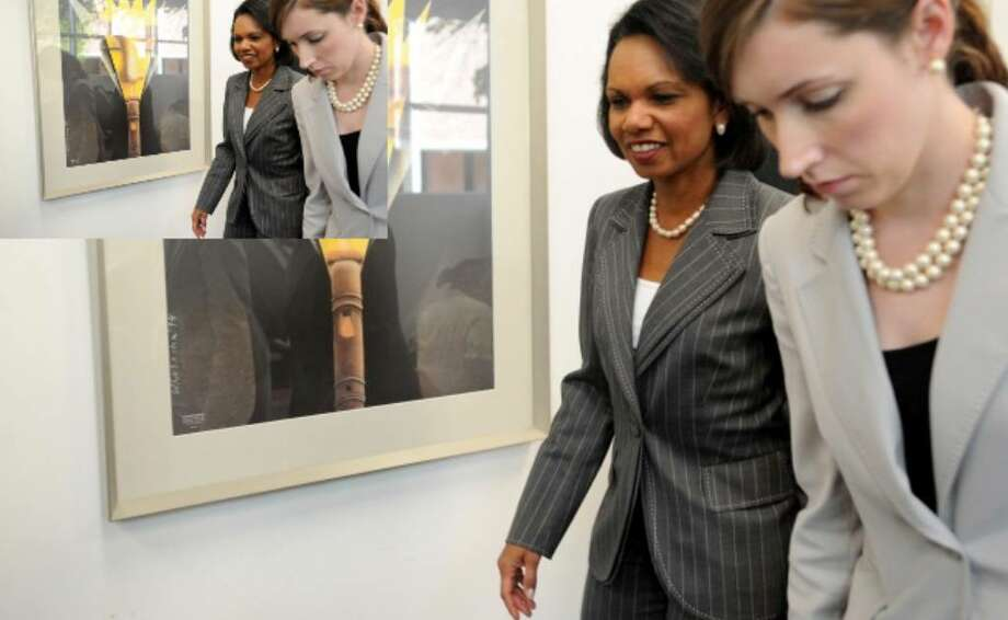 Former U.S. Secretary of State Condoleezza Rice (left) exits after meeting the media at Trinity University shortly before speaking as part of the Flora Cameron Lecture on Politics and Public Affairs series on Wednesday.