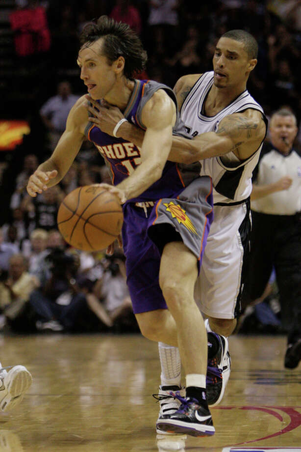 San Antonio Spurs George Hill is called for a reach in foul against Phoenix Suns Steve Nash. The Suns defeated the Spurs, 107-101, to complete a sweep of the Western Conference semifinals on Sunday, May 9, 2010. / glara@express-news.net