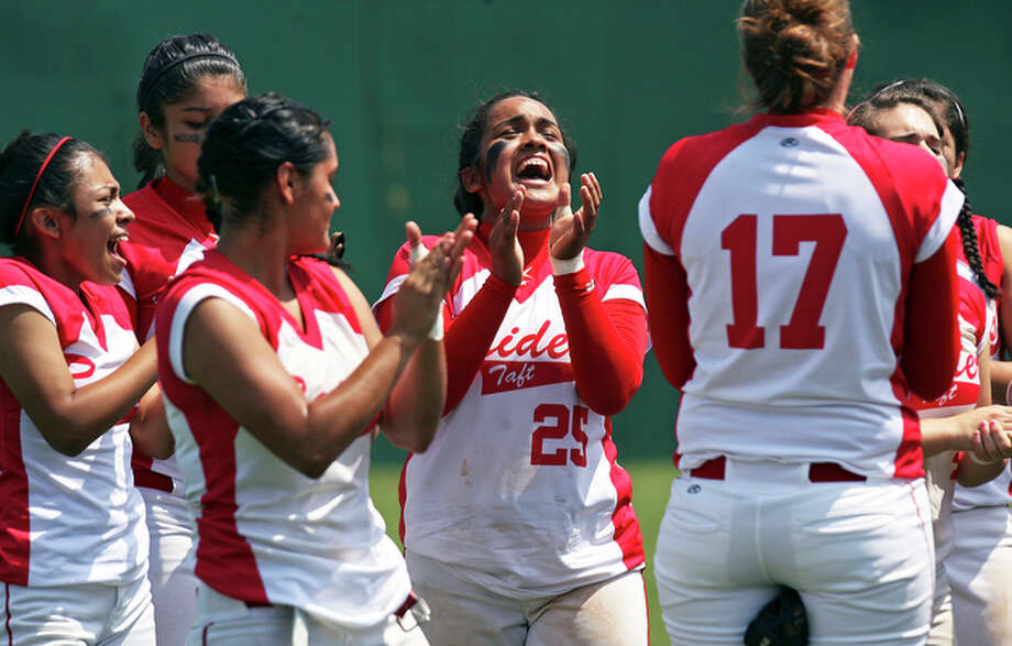 Taft's Laura Rodriguez (25) celebrates with teammates as the Raiders beat Judson 3-1 and advance in the playoffs with their 2-0 series victory in class 5A bi-district action at the North East softball complex on May 1, 2010. / © 2010 San Antonio Express-News