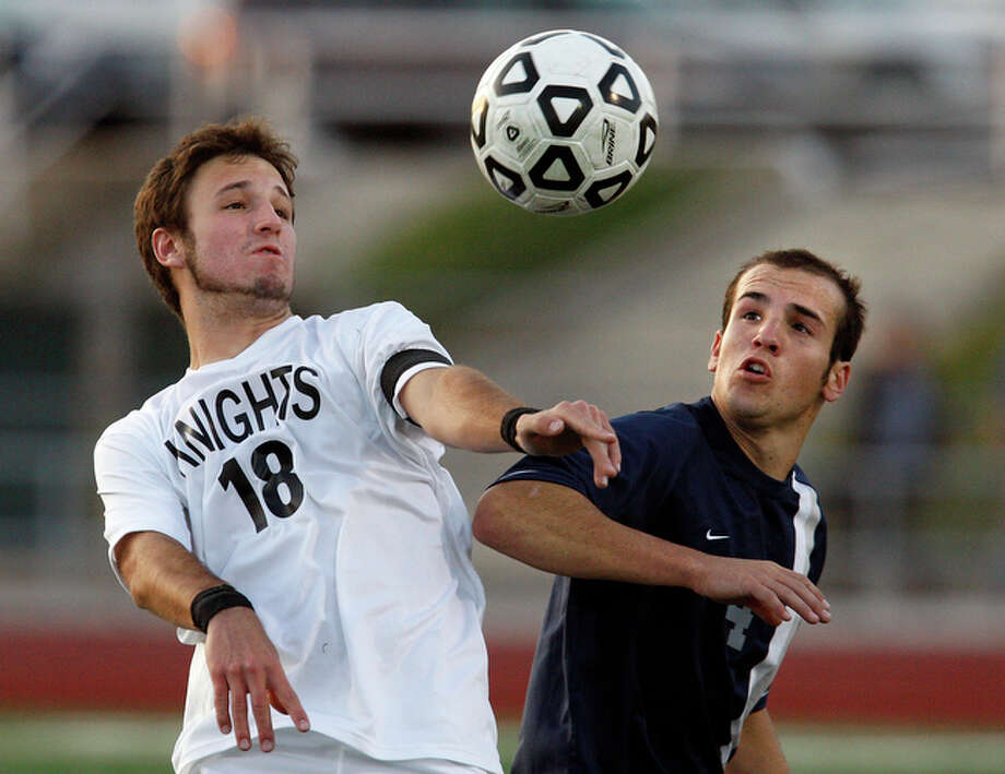 Boerne Champion's Forrest Voss (04) and Steele's Yoshua Weingerz (18) battle for position during their Class 4A boys soccer playoff match at Comalander Stadium on Friday, Mar. 26, 2010. Boerne Champion defeated Steele in a shootout after double overtime. / San Antonio Express-News