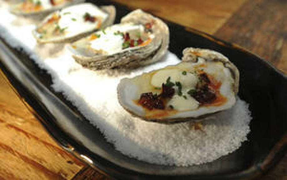 The Hyatt Regency Hill Country Resort and Spa features briny oysters topped with Spanish-style chorizo and cave-aged white cheddar.