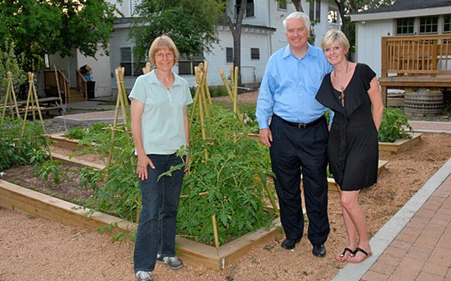 Dignowity Community Garden Manager Barb Garcia, left, Catholic Worker House Board President Mark Wittig and Wells Fargo representative Jennifer Moriarty at the Dignowity Community Garden.