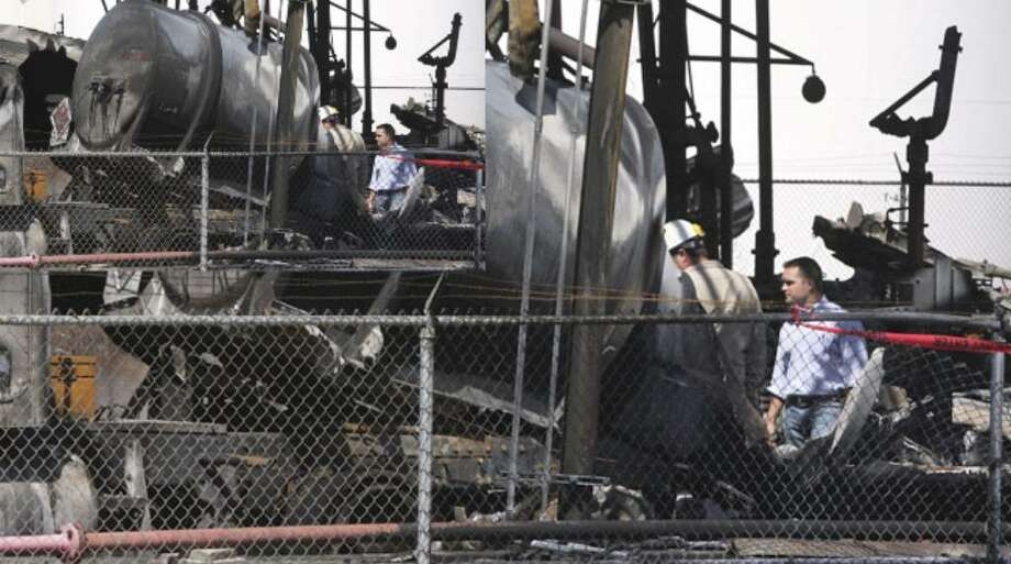 Investigators search for the cause of the explosion and fire at AGE Refining Inc, on May 6.