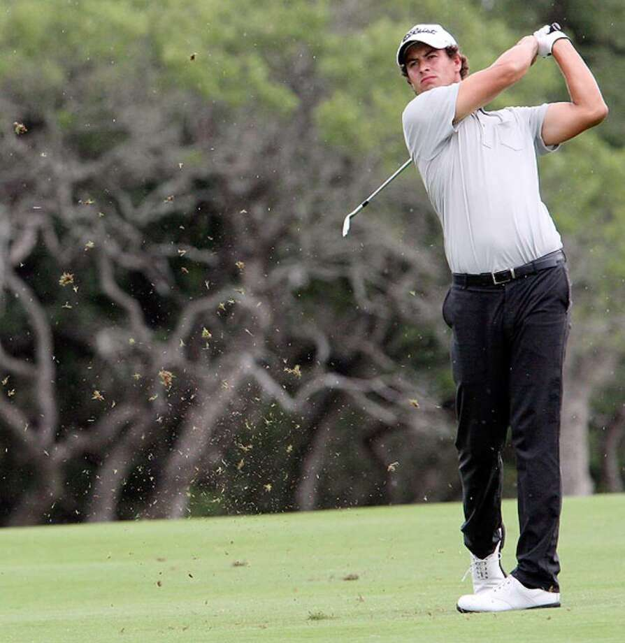 Adam Scott watches his approach shot on the ninth hole during Sunday's final round of Valero Texas Open.