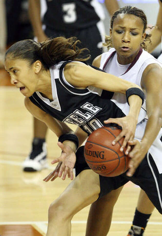 Steele's Meighan Simmons drives into Mansfield Timberview's Maegan Conwright on Thursday. Simmons went 10 for 27 in the state-semifinal loss to Timberview; her teammates went 0 for 28.