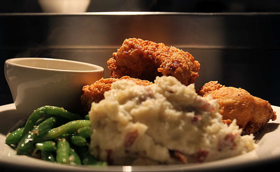 Buttermilk fried chicken is served with mashed potatoes, gravy and green beans at Auden's Kitchen. / spoecial to the San Antonio Express-News