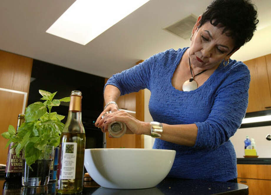 "Cynthia Guido (above) says cooking nearly always ends better with such approaces as ""a happy heart, an open mind"" along with ""a simple plan and love."" / SAN ANTONIO EXPRESS-NEWS"