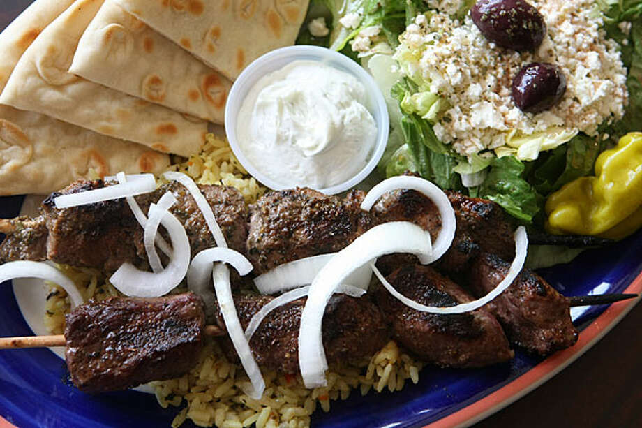 The traditional plate features skewered lamb and beef served with a tzatziki sauce, Greek salad and pita bread. / SAN ANTONIO EXPRESS-NEWS