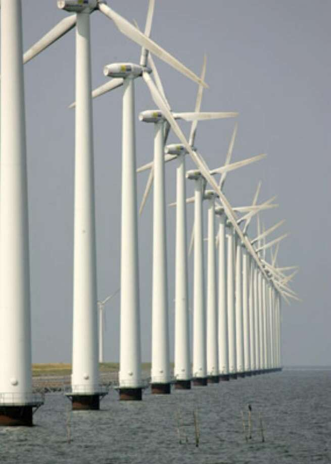 Wind turbines are seen in Dronten, the Netherlands. Offshore wind developers say the Cape Wind project could be the start of a homegrown industry, with thousands of new manufacturing jobs, and a predictably priced domestic energy source.