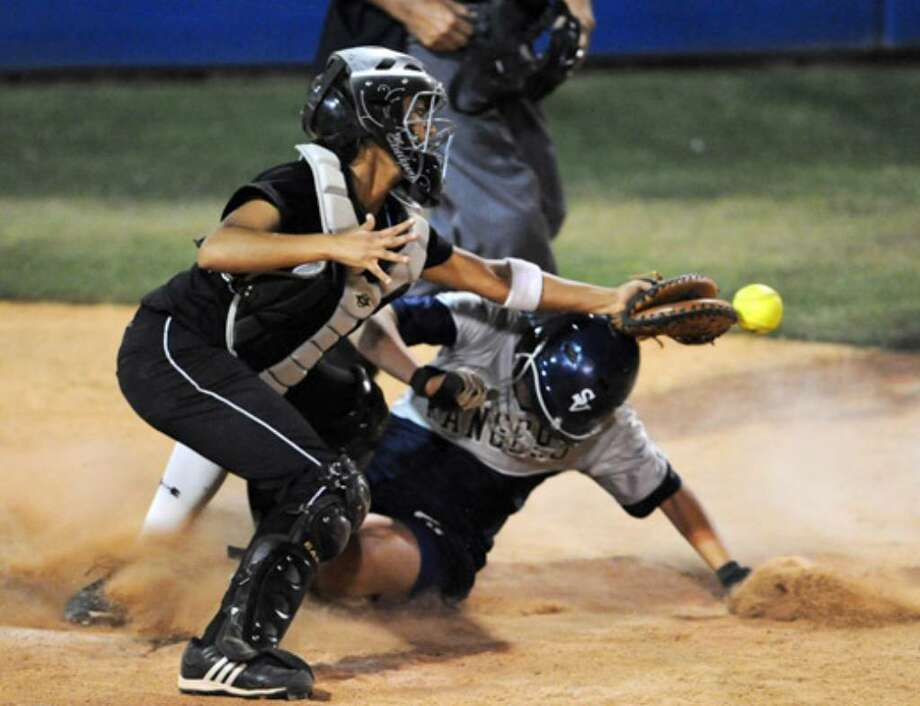 Smithson Valley's Katie Repole slides under Clark's Rochelle Nash for the winning run.