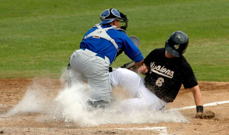 Tulsa catcher Dayton Buller tags out James Darnell of the Missions at home in the bottom of the fourth inning Tuesday afternoon. San Antonio was limited to 11 runs and batted only .214 during its six-game homestand, during which the Missions went 2-4.