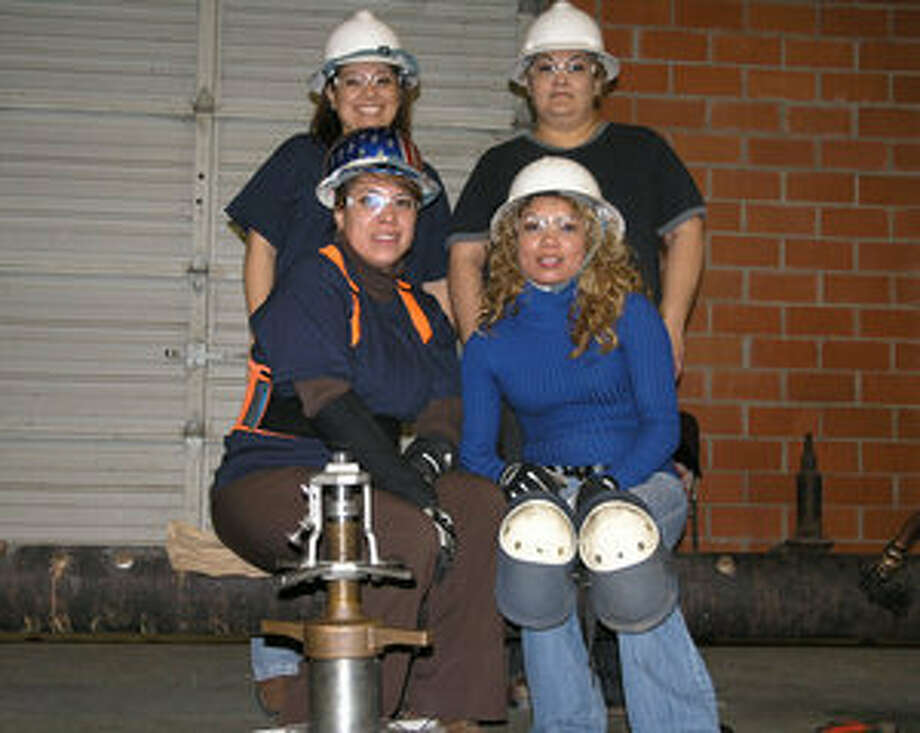 Members of the Bexar Metropolitan Water District women's Pipe-Tapping team include from front, left to right, Madeleine Garcia, Rosie Castillo, (back, left to right) Rebecca Ledesma and Cindy Soliz.