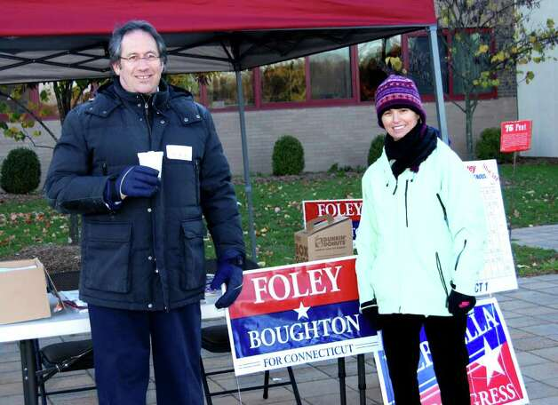 Roy Abramowitz and Michelle Sriubas welcome voters at the Republican booth outside New Canaan High School Photo: Jeanna Petersen Shepard / New Canaan News